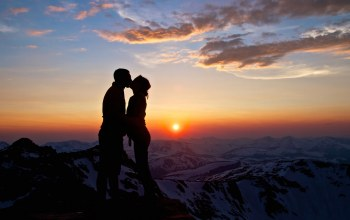 Sunset,mountains,boy,snow,couple,woman,hug,girl,clouds,sky