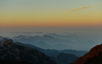 fog,anhui,clouds,sunrise,mountain range,mountains,china,Huangshan