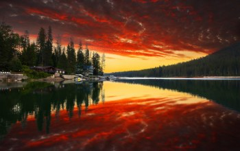 water,sky,houses,park,clouds,river,forest,trees,reflection,Sunset,mountains