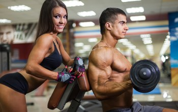 pose,Dumbbell,herculean arm,look,smiling,muscles,woman,training