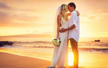 beach,kissing,just married,bride,wedding,Sunset,happy,couple