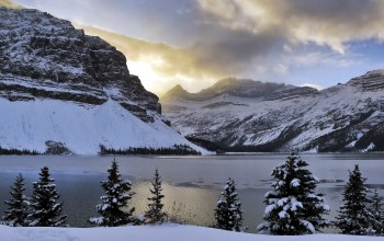 snow,mountains,alberta,bow lake,ca,clouds,trees,light