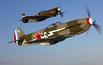 with john hinton flying the north american p-51a mustang,Yakovlev yak-3