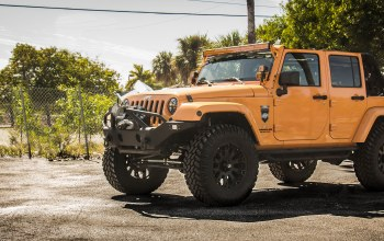 big rims,Jeep wrangler,tires,wheels,orange,sahara,jeep