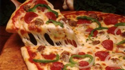 dish,pizza,bell pepper,Tomato,italian cuisine,onion,cheese,olive,mushroom,sausage