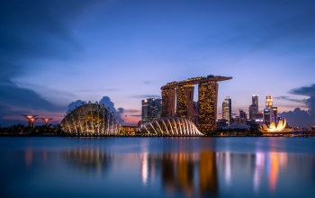 skyscrapers,Sunset,architecture,lights,Singapore,gardens by the bay,clouds,blue sky,evening