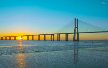 vasco da gama,water,Sunset,bridge