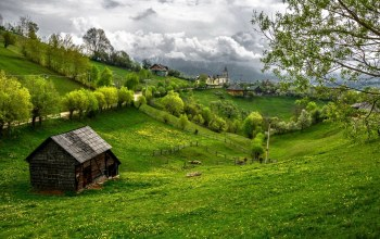 hills,Road,grass,house,mountains