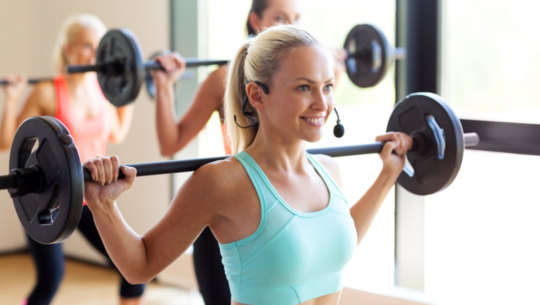 trainer,woman,aerobics class with weight