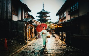 raining,street,village,umbrella,car,woman