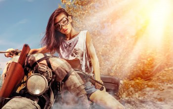 brunette,motorcycle,dirt glasses,gun,pose