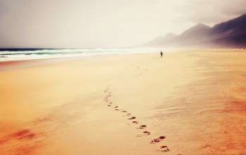 waves,footprints,seaside,hills,trail,ocean,beach,sand