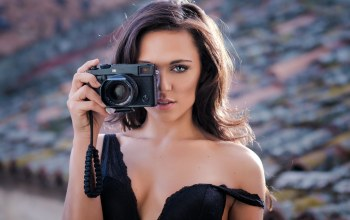 portrait,girl,Cleavage,depth of field,looking at camera,long hair,dress,photographer,photo,lips,blue eyes,bare shoulders,tits,open mouth,looking at viewer,close up,camera,Face,brunette,chest,breast,Antonio Girlando,mouth,strap,black dress