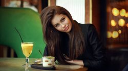 lips,straight hair,depth of field,sitting,smiling,red nails,looking at camera,long hair,model,looking at viewer,girl,cocktail,photo,table,green eyes,Face,brunette,portrait,mouth