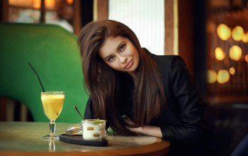 lips,straight hair,depth of field,sitting,smiling,red nails,looking at camera,long hair,looking at viewer,girl,cocktail,photo,table,green eyes,Face,brunette,portrait,mouth