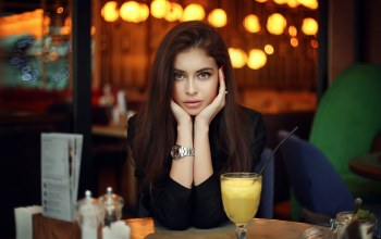 brunette,depth of field,cocktail,photo,girl,long hair,red nails,green eyes,looking at camera,lips,looking at viewer,Face,mouth,table,portrait,straight hair