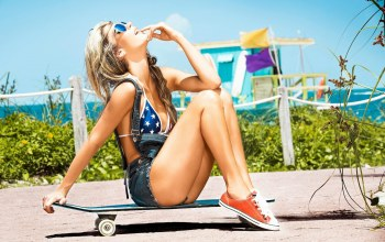 bare shoulders,long hair,bikini top,chest,mouth,tits,finger in mouth,lips,wavy hair,sunglasses,blonde,legs,body,skateboard,Mara Roldan,jean shorts,shorts,open mouth,Face,hips,Sneakers,breast,girl,sitting