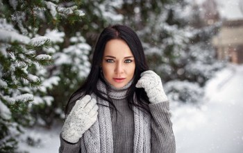 Face,bokeh,looking at camera,blue eyes,Denis Petrov,tree,snowflakes,scarf,sweater,angelina petrova,makeup,long hair,photographer,looking at viewer,coniferous,photo,girl,brunette,lips,beauty,straight hair,mittens,mouth,gloves,winter,branches,black hair,snow,depth of field,portrait