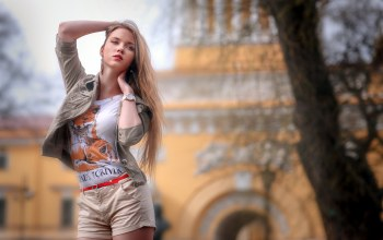 girl,lips,shirt,photo,hand in hair,long hair,depth of field,portrait,mouth,bokeh,straight hair,arms up,looking away,lipstick,t-shirts,open shirt,legs,shorts,Red lipstick,tree,photographer,Face,clear eyes,blonde,Sergej Rekhov