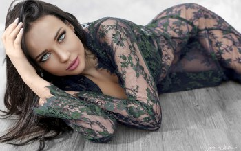 chemise,portrait,long hair,straight hair,Floor,girl,hand in hair,black hair,Cleavage,mouth,angelina petrova,looking at camera,Javier Ullastres,photo,photographer,Face,see-through clothing,green eyes,lips,beauty,looking at viewer,on the floor,brunette