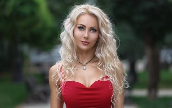 wavy hair,close up,blonde,Face,strap,looking at the viewer,looking at camera,blue eyes,mouth,long hair,portrait,dress,bare shoulders,lips,lipstick,red dress,photographer,necklace,girl,photo,depth of field