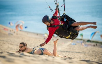 woman,funny,situation,girl,sand,boy,beach,humor,smiling,paragliding,sport