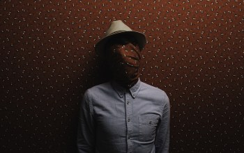 covered face,Hat,dress shirt,wallpaper