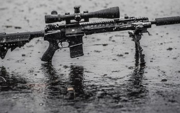 water,telescopic sight,rain,assault rifle,wet,tripod