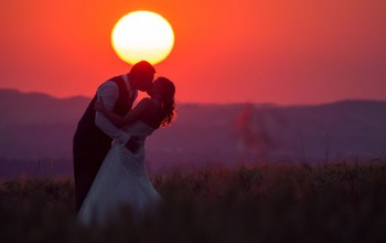 fireball,couple,hill,wedding,bride,red sky,Sunset,silhouette,Twilight,groom,dusk