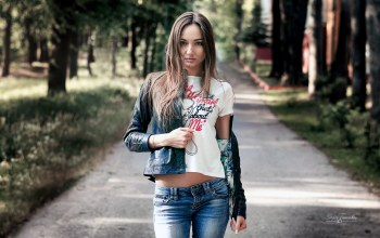black jacket,straight hair,trees,Face,looking at camera,Sergey Tomashev,mouth,depth of field,portrait,lips,photo,long hair,blue eyes,brunette,leather jacket,Jeans,bokeh,brown hair,looking at viewer,park,pants,photographer,pose,girl