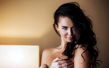 green eyes,looking at camera,girl,photographer,Fotoshi Toshi,mouth,sensual gaze,brunette,portrait,Anton Kharisov,lips,Anton Harisov,strategic covering,looking at viewer,wavy hair,bare shoulders,smiling,close up,Face,long hair,photo,depth of field