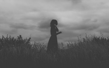 black dress,clouds,field,girl