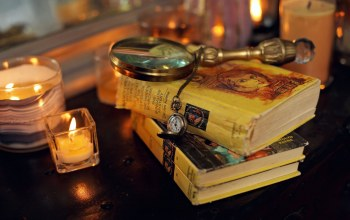 candles,miscellanea,table,pocket watch,clock,Magnifying glass,books