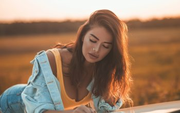 jacket,tank top,girl,depth of field,photo,lips,Cleavage,closed eyes,jean shorts,jeans jacket,chest,long hair,Sonny Bui,shorts,portrait,mouth,wavy hair,nose ring,brunette,photographer,breast,model